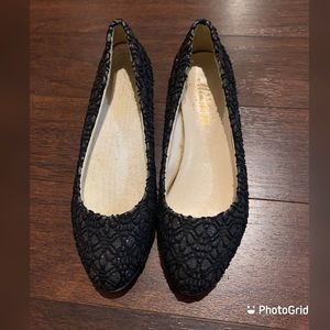 Black sparkly flats with golden plated heel